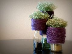 Hotel wedding decorating ideas | purple-green-wedding-decoration-ideas.001 — Wedding Ideas, Wedding     Cool idea, babies breath in different size jars with rocks in the bottom.  No fire hazard!  Could be great for like, every third row as aisle decorations.  We can pull this off easy...
