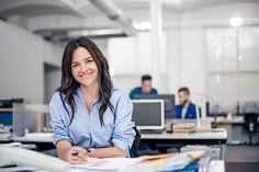 Portrait of confident businesswoman at desk