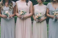 bridesmaids in mix and match dresses in blush and light gray @myweddingdotcom