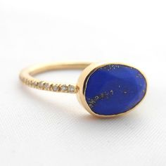 Lapis set in 14k yellow gold and white diamond band. Liz carefully handpicks each stone and works with some of the most talented artisans in Jaipur to handcraft  $1100