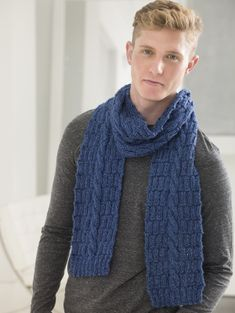Take your knitting to a new level with this cabled scarf made with Heartland.