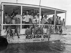 Florida Memory - Many people stand in the stern of a party boat hung with several strings of fish caught during the Destin Rodeo - Destin, Florida