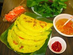 Banh xeo - Vietnamese sizzling cake.  Learn how to make banh xeo at http://danangfoodie.com/vietnamese-sizzling-cakes/ . #banhxeo #Vietnamesesizzlingcake #pancake #danang #streetfood #danangfoodietour