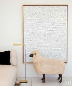 A Lalanne sheep stands before a painting by Sean Landers. Photo. Roger Davies