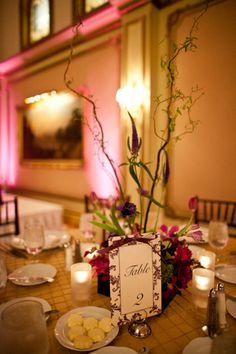 Centerpieces like this?  Simpler and no worry about obstructing views etc?