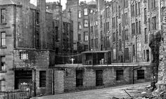 Amazing image of the tenements at the corner of High St and Duke Street, Glasgow,  in March 1973, with one wee lassie skipping and, no doubt, singing to herself...