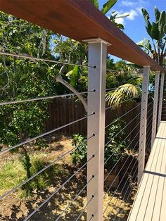 DIY Deck Railing Ideas & Designs That Are Sure to Inspire You If your favorite outdoor space is your deck, we give you over 14 inspiring Deck Railing Ideas to show how you can spruce it up, from DIY to store bought. Deck Railing Design, Deck Railings, Deck Design, Railing Ideas, Glass Railing, Stair Railing, Cable Fencing, Cable Railing Systems, Deck Construction