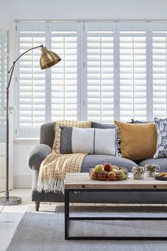 These full-height shutters - part of the Atmosphere range from the House Beautiful collection at Hillarys - cover the entire window for privacy and contemporary elegance. Choose a pale blue finish to create depth in a neutral living room.