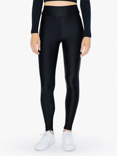 A slimming silhouette constructed from smooth shine fabrication for a soft feel and superior water-wicking lining. The Nylon Tricot High-Waist Leggings features a high waist, thick, elastic waistband, tapered legs, and a perfect sheen. These leggings wear true to size for a figure-flatting fit, similar to the Cotton Spandex Jersey High-Waist Leggings.
