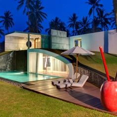 Stunning Villa Sapi with its own private beach, surrounded by coconut trees, on Lombok Island in Indonesia.