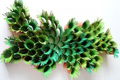 Nature-inspired wall sculpture from paper towel rolls