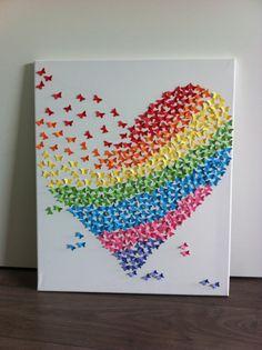Geïnspireerd door iemand die een hart van vlinders had gemaakt en daar m'n eigen draai aan gegeven! Trots op het vrolijke en kleurrijke eindresultaat!