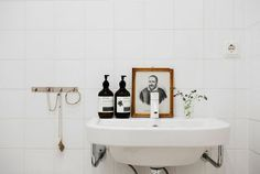 B L O O D A N D C H A M P A G N E . C O M I really like artworks in the bathroom the white on white fixture and wash basin are a plus with the contrasting Black soap