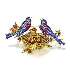 18 KARAT GOLD, PLATINUM, RUBY AND SAPPHIRE BIRD BROOCH, VAN CLEEF & ARPELS, NEW YORK, CIRCA 1950