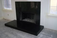 black tile fireplace surround - Google Search