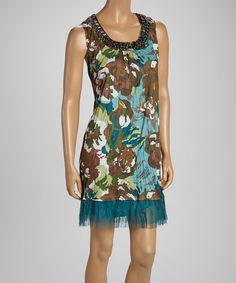 This+fiercely+fabulous+tunic+boasts+a+splashy+floral+print+and+features+a+sheath+shape+for+comfortably+chic+fit.+The+lacy+hem+puts+a+feminine+finishing+touch+on+this+fun,+party-perfect+piece.