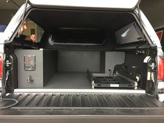 2017 Toyota Tacoma TRD PRO custom build rear truck bed cargo storage system. On-board water, jet pump, electric, slide out fridge/freezer, custom molle panel and cargo lighting.