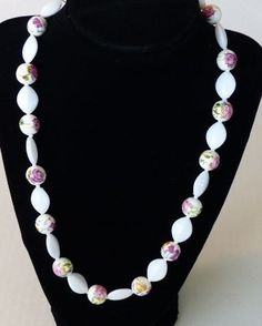 Shiny white and floral bead necklace by mizmlu on Etsy, $19.95. Perfect summer accessory.