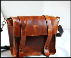 This handmade stunner of a leather bag looks better and better with age. What's better than that? $169.99