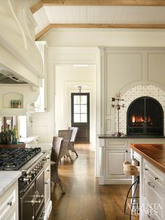 I love the look of a fireplace at counter height in the kitchen