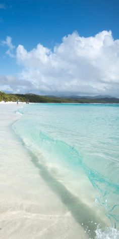 Gentle waves rolling into Whitehaven Beach, Hamilton Island - by Pauly Vella #aromabotanical