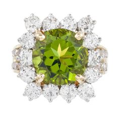 6.20 Carat Peridot and Diamond Cluster Ring | From a unique collection of vintage cluster rings at https://www.1stdibs.com/jewelry/rings/cluster-rings/