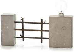 Industrial concrete lamp with exposed rebar.
