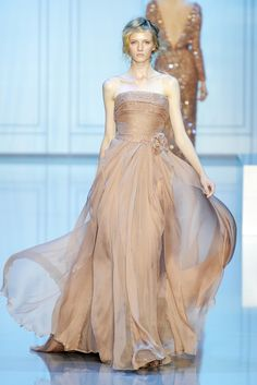 Elie Saab F 2011: Exquisite gown for the holidays! The flecks of gold in the bodice add some sparkle, shine, and shimmer.