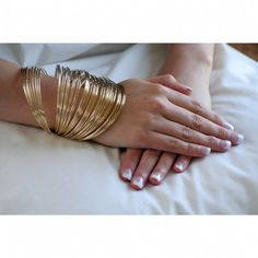 my signature style: a trillion bangles stacked up all the way up my forearm - need 2 or 3 sets per arm