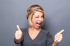 Photo : wink and seduction concepts - flirting young woman winking and smiling for cool attitude, gray background studio