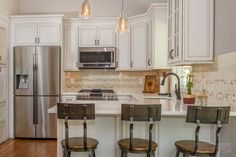 This Maple Kitchen Features Starmark Cabinets In The Brisbane Door Style  With A White Tinted Varnish Finish With A Cottage And Bronze Glaze And A  Cambria ...