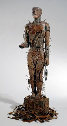The figure was originally conceived by Saar as part of a tableau entitled Crossroads, which was recreated in the museum in 1993. In the context of the other works, this piece represented the products of man, which the artist notes can be used for good (tools) or evil (weapons).  Opposite him there stood a sculpture of a woman with long roots extending from her legs downward to denote nature.