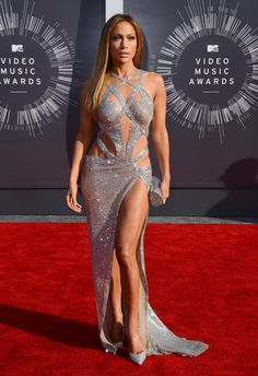 Jennifer Lopez arrives at the MTV Video Music Awards at The Forum on Sunday, Aug. in Inglewood, Calif. (Photo by Jordan Strauss/Invision/AP) Jennifer Lopez Body, Jennifer Lopez Photos, Sexy Dresses, Nice Dresses, Fashion Dresses, J Lo Fashion, See Through Dress, Glamour, Cutout Dress
