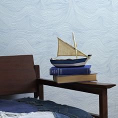 Not sure how this would work with a beadboard wall, but holy schnikies, this wave pattern wallpaper is faboo...in a $93/roll kind of way.