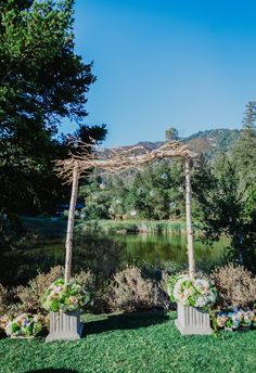 Pink and white florals, natural arbor, branches // Milou And Olin Photography