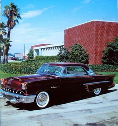 """1952 Mercury restyled by Joe Bailon of Bailon Custom Shop for San Francisco Kustom Kings member Ed Russell of San Francisco, California. The car is also known as the """"Le Lancia"""". Joe painted the car in a Candy Apple Maroon called Futurama. After painting it he drove it down to Barris Kustoms in order to have their house striper Dean Jeffries apply gold scallops. In 1958 Ed's Mercury was nominated as one of 28 """"Top Customs of the Year"""" by Motor Life magazine."""