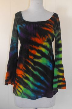 A rainbow in black tiger stripes! Its a loose fit roomy tunic with side slits, raglan bell sleeves are long with two gathered tiers. Its made from