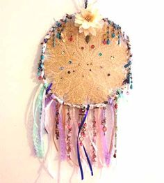 How To Make Doily Dream Catchers  I think i'd use more natural color streamers...and maybe a few feathers from the craft store. Cute idea!