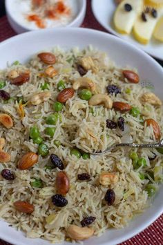 A delicious saffron-flavored mild Kashmiri pulao with peas, dry fruits, & nuts made in Instant Pot with the signature Kashmiri spices - fennel & dry ginger. Veg Recipes, Indian Food Recipes, Vegetarian Recipes, Cooking Recipes, Kashmiri Recipes, Veg Fried Rice Recipe, Kulfi Recipe, Paneer Dishes, Rice