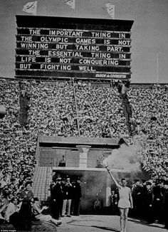 The Olympic torch is presented at the 1948 Summer Olympic Games at Wembley Stadium in London