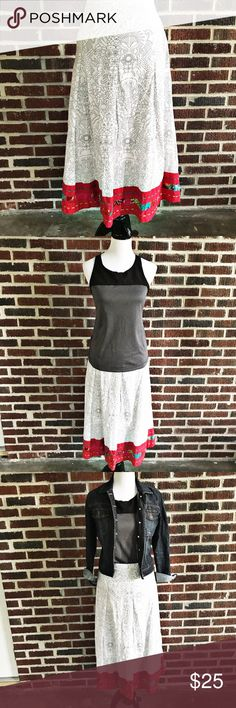 "Choices Woman's Skirt Adorable skirt that makes me want to go buy a coloring book. 😉.  White with black line details and a contrasting detailed hem with some hand stitching. This could be a summer go to favorite.  Throw on a top and sandals and you're good to go.  Pair with a jean jacket as shown in pictures.  Has a hidden side zipper with button closure.  Waist measures ~ 21"" side to side and length measures ~ 31"". Is fully lined and pleated to give it some body. Choices Woman Skirts"