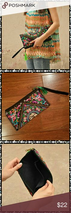 """Colorful satin clutch / wristlet. This clutch is so pretty. With an embroidered Asian inspired pattern on both sides. The purse has a black background with beautiful embroidery in pink, purple, turquoise, green, gold, and cream. There's a cute green tassel hanging from the zipper. Includes wrist strap. Approximate size is 10.5"""" x 5.75"""". New in manufacture packaging. Boutique Chic  Bags Clutches & Wristlets"""