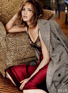 Basic Instinct - Lawrence feels more herself on a movie set than anywhere else. Ralph Lauren Collection wool-houndstooth coat and maroon satin dress with beaded detail.