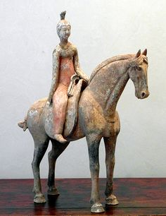 "Reader Lady Tang Dynasty (618-906) Seated on the saddle (remouvable from the horse)  with polychromy  H.45cm L.41cm  Oxford   -- Reader lady ?? Shouldn't it be ""rider lady"" ?"