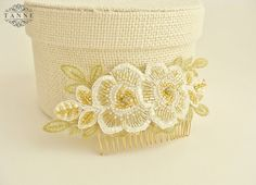 This elegant bridal hair comb with layers of lace in shades of gold and ivory is completely hand-beaded with seed beads and crystal rhinestone accents. Each one is lovingly handmade with the utmost detail and care. Gold and milky white seed beads feature a shimmering hint of silver and gold running along their stringing holes(lined) for just a pinch of extra sparkle.  The headpiece is versatile so you can choose how to combine it into your hairstyle. This bridal hair accessory perfectly…