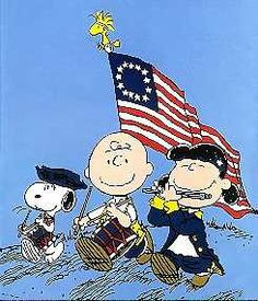 Peanuts (Snoopy, Lucy, and Charlie Brown) dressed as Minutemen marching in a Fife and Drum Parade with a 13 star American Flag, the Stars and Stripes.