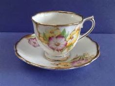 Royal Albert 'Petunia' pattern teacup and saucer in yellow and pink