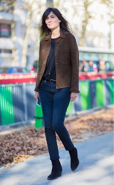 Brown suede jacket casually worn with jeans and booties.