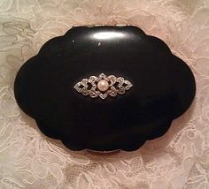 Vintage 1960s Kigu Bolero. Black enamel with a marcasite and faux pearl jewel. Ornate but very slim and light!