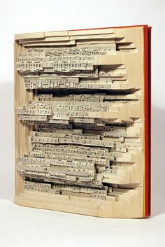 """Brian Dettmer Enjoyment of Music 2008 Altered Book 9-1/4"""" x 8"""" x 3-1/4"""" Image Courtesy of the Artist and Kinz + Tillou Fine Art"""